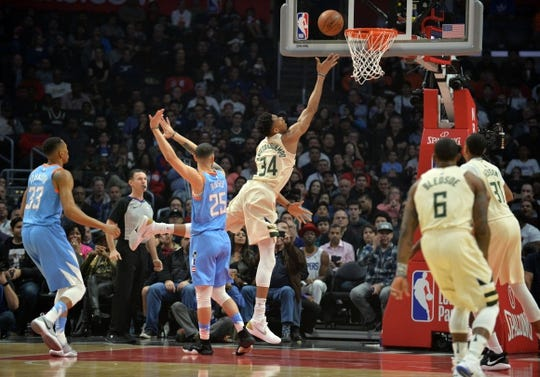 March 27, 2018; Los Angeles, CA, USA; Milwaukee Bucks forward Giannis Antetokounmpo (34) moves to the basket ahead of Los Angeles Clippers guard Austin Rivers (25) during the first half at Staples Center. Mandatory Credit: Gary A. Vasquez-USA TODAY Sports