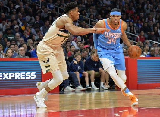 March 27, 2018; Los Angeles, CA, USA; Los Angeles Clippers forward Tobias Harris (34) moves to the basket against Milwaukee Bucks forward Giannis Antetokounmpo (34) during the first half at Staples Center. Mandatory Credit: Gary A. Vasquez-USA TODAY Sports