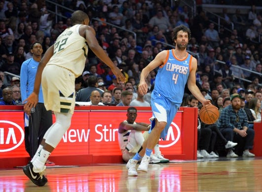 March 27, 2018; Los Angeles, CA, USA; Los Angeles Clippers guard Milos Teodosic (4) moves the ball against Milwaukee Bucks forward Khris Middleton (22) during the first half at Staples Center. Mandatory Credit: Gary A. Vasquez-USA TODAY Sports