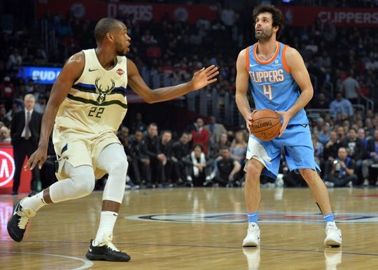 March 27, 2018; Los Angeles, CA, USA; Los Angeles Clippers guard Milos Teodosic (4) controls the ball against Milwaukee Bucks forward Khris Middleton (22) during the first half at Staples Center. Mandatory Credit: Gary A. Vasquez-USA TODAY Sports