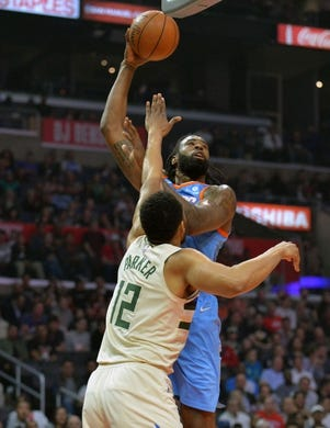 March 27, 2018; Los Angeles, CA, USA; Los Angeles Clippers center DeAndre Jordan (6) moves to the basket against Milwaukee Bucks forward Jabari Parker (12) during the first half at Staples Center. Mandatory Credit: Gary A. Vasquez-USA TODAY Sports