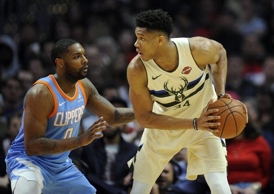 March 27, 2018; Los Angeles, CA, USA; Milwaukee Bucks forward Giannis Antetokounmpo (34) moves the ball against Los Angeles Clippers guard Sindarius Thornwell (0) during the first half at Staples Center. Mandatory Credit: Gary A. Vasquez-USA TODAY Sports