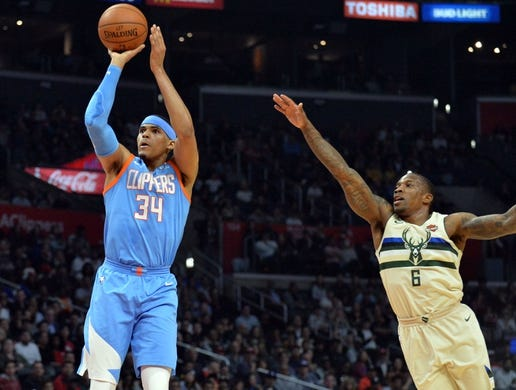March 27, 2018; Los Angeles, CA, USA; Los Angeles Clippers forward Tobias Harris (34) shoots ahead of Milwaukee Bucks guard Eric Bledsoe (6) during the first half at Staples Center. Mandatory Credit: Gary A. Vasquez-USA TODAY Sports