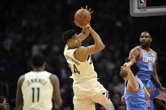 March 27, 2018; Los Angeles, CA, USA; Milwaukee Bucks forward Giannis Antetokounmpo (34) passes against the defense of Los Angeles Clippers guard Milos Teodosic (4) during the first half at Staples Center. Mandatory Credit: Gary A. Vasquez-USA TODAY Sports