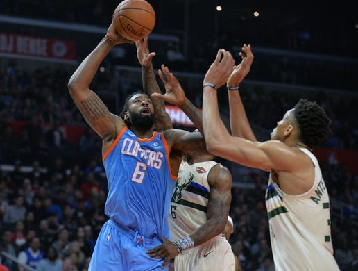 March 27, 2018; Los Angeles, CA, USA; Los Angeles Clippers center DeAndre Jordan (6) moves to the basket against Milwaukee Bucks forward Giannis Antetokounmpo (34) during the first half at Staples Center. Mandatory Credit: Gary A. Vasquez-USA TODAY Sports