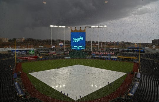 Apr 13, 2018; Kansas City, MO, USA; A general view of the tarp on the field before the game between the Los Angeles Angels and the Kansas City Royals at Kauffman Stadium. Mandatory Credit: Jay Biggerstaff-USA TODAY Sports