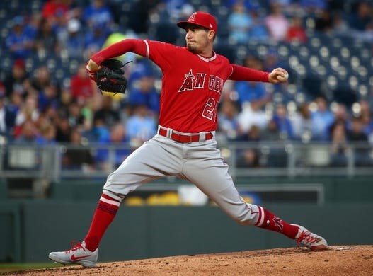 Apr 13, 2018; Kansas City, MO, USA; Los Angeles Angels starting pitcher Andrew Heaney (28) pitches against the Kansas City Royals in the first inning at Kauffman Stadium. Mandatory Credit: Jay Biggerstaff-USA TODAY Sports