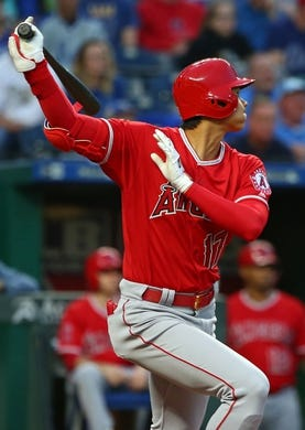 Apr 13, 2018; Kansas City, MO, USA; Los Angeles Angels designated hitter Shohei Ohtani (17) hits a double against the Kansas City Royals in the second inning at Kauffman Stadium. Mandatory Credit: Jay Biggerstaff-USA TODAY Sports