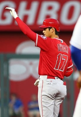 Apr 13, 2018; Kansas City, MO, USA; Los Angeles Angels designated hitter Shohei Ohtani (17) waves to the dugout after hitting a double against the Kansas City Royals in the second inning at Kauffman Stadium. Mandatory Credit: Jay Biggerstaff-USA TODAY Sports