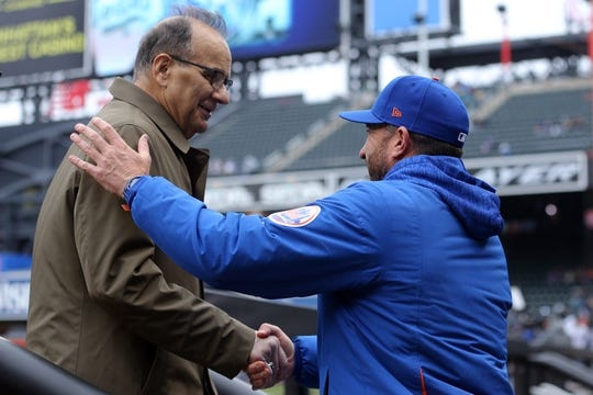 Apr 15, 2018; New York City, NY, USA; New York Mets manager Mickey Callaway (right) welcomes MLB chief baseball officer Joe Torre to the dugout before a game against the Milwaukee Brewers at Citi Field. Mandatory Credit: Brad Penner-USA TODAY Sports