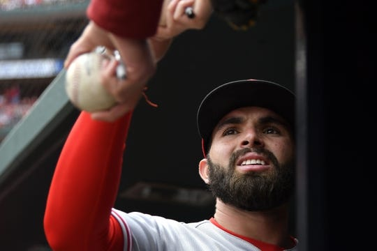 Apr 21, 2018; St. Louis, MO, USA; Cincinnati Reds shortstop Jose Peraza (9) signs autographs prior to a game against the St. Louis Cardinals at Busch Stadium. Mandatory Credit: Jeff Curry-USA TODAY Sports