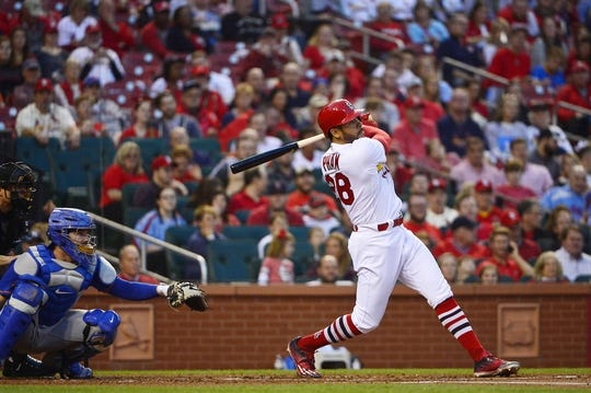Apr 24, 2018; St. Louis, MO, USA; St. Louis Cardinals center fielder Tommy Pham (28) hits a two run home run off of New York Mets starting pitcher Zack Wheeler (not pictured) during the first inning at Busch Stadium. Mandatory Credit: Jeff Curry-USA TODAY Sports