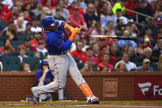 Apr 24, 2018; St. Louis, MO, USA; New York Mets left fielder Yoenis Cespedes (52) breaks his bat as he lines out to St. Louis Cardinals third baseman Matt Carpenter (not pictured) during the first inning at Busch Stadium. Mandatory Credit: Jeff Curry-USA TODAY Sports