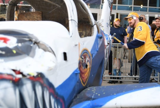 Apr 27, 2018; Nashville, TN, USA; Nashville Predators fan Shane Campbell hits the back end of a smash plane before game one of the second round of the 2018 Stanley Cup Playoffs against the Winnipeg Jets at Bridgestone Arena. Mandatory Credit: Christopher Hanewinckel-USA TODAY Sports