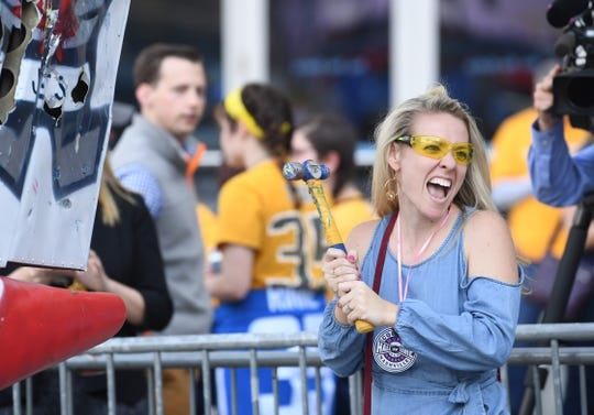 Apr 27, 2018; Nashville, TN, USA; Nashville Predators fan Kathleen Collins reacts after hitting a smash plane with a hammer prior to game one of the second round of the 2018 Stanley Cup Playoffs against the Winnipeg Jets at Bridgestone Arena. Mandatory Credit: Christopher Hanewinckel-USA TODAY Sports