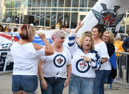 Apr 27, 2018; Nashville, TN, USA; Winnipeg Jets fans cheer after kissing a smash plane prior to game one of the second round of the 2018 Stanley Cup Playoffs against the Nashville Predators at Bridgestone Arena. Mandatory Credit: Christopher Hanewinckel-USA TODAY Sports