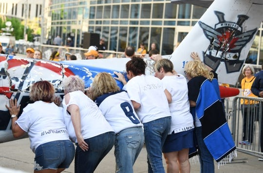 Apr 27, 2018; Nashville, TN, USA; Winnipeg Jets fans kiss a smash plane prior to game one of the second round of the 2018 Stanley Cup Playoffs against the Nashville Predators at Bridgestone Arena. Mandatory Credit: Christopher Hanewinckel-USA TODAY Sports