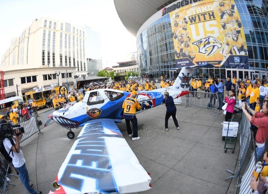 Apr 27, 2018; Nashville, TN, USA; General view of the Bridgestone plaza as Nashville Predators fans hit a smash plane with hammers before game one of the second round of the 2018 Stanley Cup Playoffs against the Winnipeg Jets at Bridgestone Arena. Mandatory Credit: Christopher Hanewinckel-USA TODAY Sports