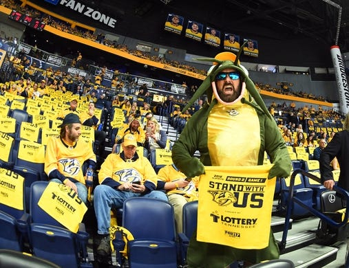 Apr 27, 2018; Nashville, TN, USA; Nashville Predators fan Wayne Hutton watches warmups dressed as a catfish before game one of the second round of the 2018 Stanley Cup Playoffs against the Winnipeg Jets at Bridgestone Arena. Mandatory Credit: Christopher Hanewinckel-USA TODAY Sports