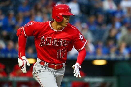 Apr 13, 2018; Kansas City, MO, USA; Los Angeles Angels designated hitter Shohei Ohtani (17) runs to first base in the first inning against the Kansas City Royals at Kauffman Stadium. Mandatory Credit: Jay Biggerstaff-USA TODAY Sports