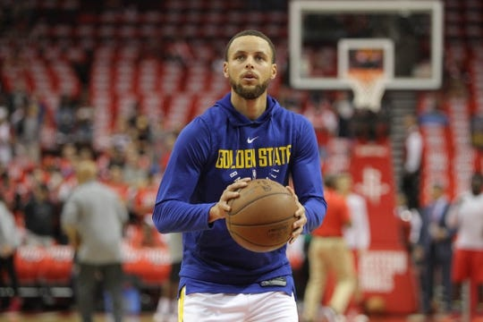 May 14, 2018; Houston, TX, USA; Golden State Warriors guard Stephen Curry (30) warms up before game one of the Western conference finals of the 2018 NBA Playoffs against the Houston Rockets at Toyota Center. Mandatory Credit: Erik Williams-USA TODAY Sports