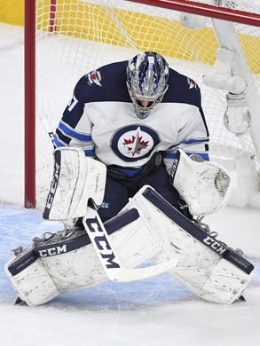 May 16, 2018; Las Vegas, NV, USA; Winnipeg Jets goalie Connor Hellebuyck (37) makes a save during the first period in game three of the Western Conference Final of the 2018 Stanley Cup Playoffs against the Vegas Golden Knights at T-Mobile Arena. Mandatory Credit: Stephen R. Sylvanie-USA TODAY Sports