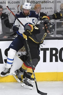 May 16, 2018; Las Vegas, NV, USA; Vegas Golden Knights defenseman Brayden McNabb (3) checks Winnipeg Jets right wing Blake Wheeler (26) into the boards during the first period in game three of the Western Conference Final of the 2018 Stanley Cup Playoffs at T-Mobile Arena. Mandatory Credit: Stephen R. Sylvanie-USA TODAY Sports