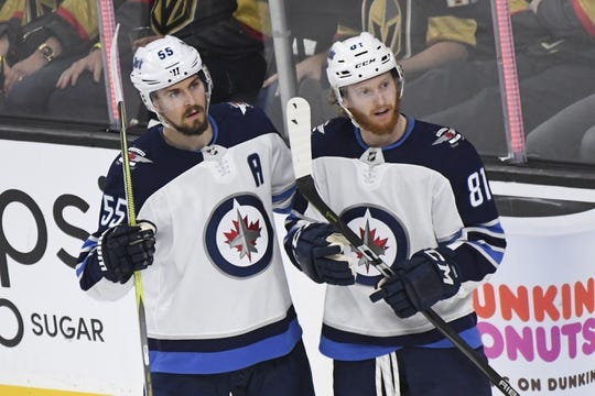 May 16, 2018; Las Vegas, NV, USA; Winnipeg Jets center Mark Scheifele (55) celebrates his goal with left wing Kyle Connor (81) during the second period in game three of the Western Conference Final of the 2018 Stanley Cup Playoffs against the Vegas Golden Knights at T-Mobile Arena. Mandatory Credit: Kirby Lee-USA TODAY Sports