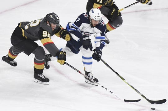 May 16, 2018; Las Vegas, NV, USA; Winnipeg Jets defenseman Ben Chiarot (7) and Vegas Golden Knights left wing Tomas Nosek (92) battle for the puck during the second period in game three of the Western Conference Final of the 2018 Stanley Cup Playoffs at T-Mobile Arena. Mandatory Credit: Kirby Lee-USA TODAY Sports
