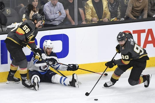 May 16, 2018; Las Vegas, NV, USA; Vegas Golden Knights left wing Tomas Tatar (90) tase the puck away from Winnipeg Jets center Paul Stastny (25) during the first period in game three of the Western Conference Final of the 2018 Stanley Cup Playoffs at T-Mobile Arena. Mandatory Credit: Stephen R. Sylvanie-USA TODAY Sports