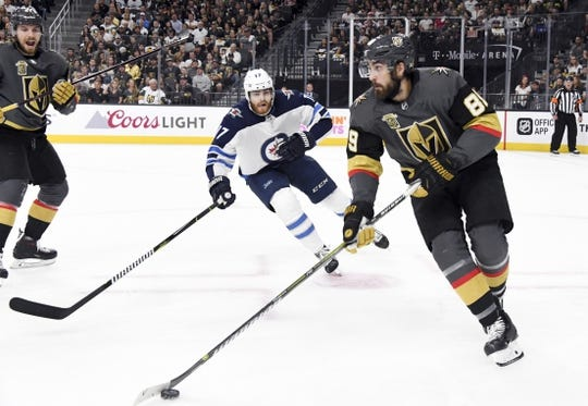May 16, 2018; Las Vegas, NV, USA; Vegas Golden Knights right wing Alex Tuch (89) moves the puck under pressure by Winnipeg Jets center Adam Lowry (17) during the first period in game three of the Western Conference Final of the 2018 Stanley Cup Playoffs at T-Mobile Arena. Mandatory Credit: Kirby Lee-USA TODAY Sports