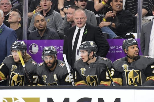 May 16, 2018; Las Vegas, NV, USA; Vegas Golden Knights head coach Gerard Gallant (center) watches from the bench during the first period in game three of the Western Conference Final of the 2018 Stanley Cup Playoffs against the Winnipeg Jets at T-Mobile Arena. Mandatory Credit: Kirby Lee-USA TODAY Sports