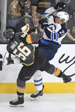 May 16, 2018; Las Vegas, NV, USA; Vegas Golden Knights left wing Erik Haula (56) and Winnipeg Jets right wing Patrik Laine (29) battle for the puck during the first period in game three of the Western Conference Final of the 2018 Stanley Cup Playoffs at T-Mobile Arena. Mandatory Credit: Stephen R. Sylvanie-USA TODAY Sports