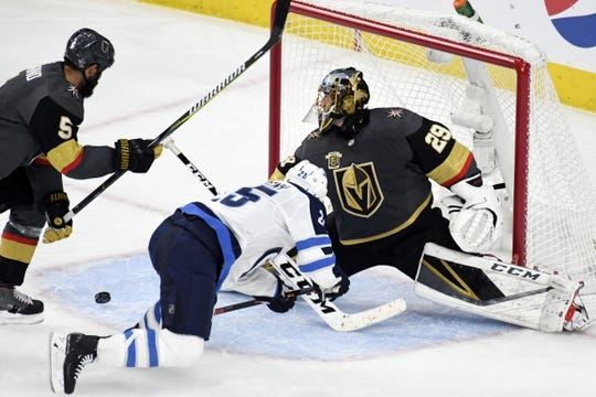 May 16, 2018; Las Vegas, NV, USA; Vegas Golden Knights goalie Marc-Andre Fleury (29) attempts to block a shot in front of Winnipeg Jets center Paul Stastny (25) during the second period in game three of the Western Conference Final of the 2018 Stanley Cup Playoffs at T-Mobile Arena. Mandatory Credit: Kirby Lee-USA TODAY Sports