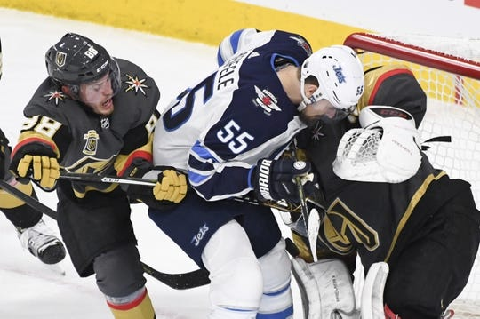 May 16, 2018; Las Vegas, NV, USA; Winnipeg Jets center Mark Scheifele (55) crashing into Vegas Golden Knights goalie Marc-Andre Fleury (29) while vying for the puck in front of defenseman Nate Schmidt (88)  during the second period in game three of the Western Conference Final of the 2018 Stanley Cup Playoffs at T-Mobile Arena. Mandatory Credit: Kirby Lee-USA TODAY Sports