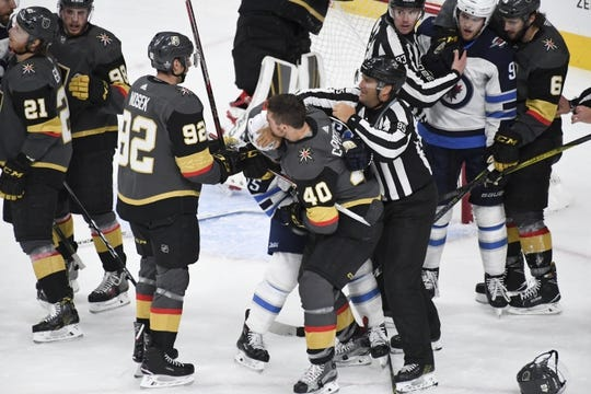 May 16, 2018; Las Vegas, NV, USA; Vegas Golden Knights center Ryan Carpenter (40) and Winnipeg Jets center Mark Scheifele (55) tussle during the second period in game three of the Western Conference Final of the 2018 Stanley Cup Playoffs at T-Mobile Arena. Mandatory Credit: Kirby Lee-USA TODAY Sports