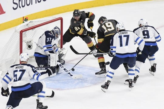 May 16, 2018; Las Vegas, NV, USA; Winnipeg Jets goalie Connor Hellebuyck (37) makes a save in front of Vegas Golden Knights right wing Reilly Smith (19) and center Jonathan Marchessault (81)during the second period in game three of the Western Conference Final of the 2018 Stanley Cup Playoffs at T-Mobile Arena. Mandatory Credit: Kirby Lee-USA TODAY Sports
