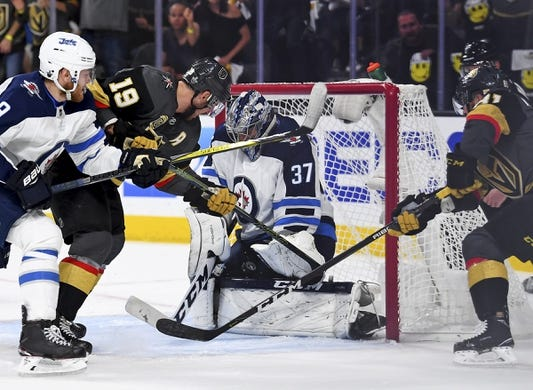May 16, 2018; Las Vegas, NV, USA; Winnipeg Jets defenseman Tyler Myers (57) makes a save in front of Vegas Golden Knights right wing Reilly Smith (19) in game three of the Western Conference Final of the 2018 Stanley Cup Playoffs at T-Mobile Arena. Mandatory Credit: Stephen R. Sylvanie-USA TODAY Sports