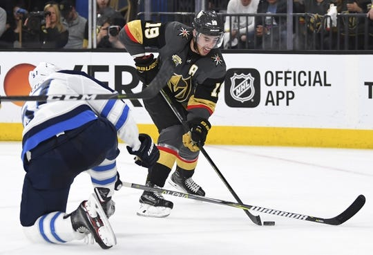 May 16, 2018; Las Vegas, NV, USA; Vegas Golden Knights right wing Reilly Smith (19) moves the puck defended by Winnipeg Jets defenseman Tyler Myers (57) in game three of the Western Conference Final of the 2018 Stanley Cup Playoffs at T-Mobile Arena. Mandatory Credit: Stephen R. Sylvanie-USA TODAY Sports