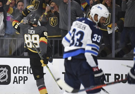 May 16, 2018; Las Vegas, NV, USA; Vegas Golden Knights right wing Alex Tuch (89) reacts after scoring a goal as Winnipeg Jets defenseman Dustin Byfuglien (33) looks on in game three of the Western Conference Final of the 2018 Stanley Cup Playoffs at T-Mobile Arena. Mandatory Credit: Stephen R. Sylvanie-USA TODAY Sports