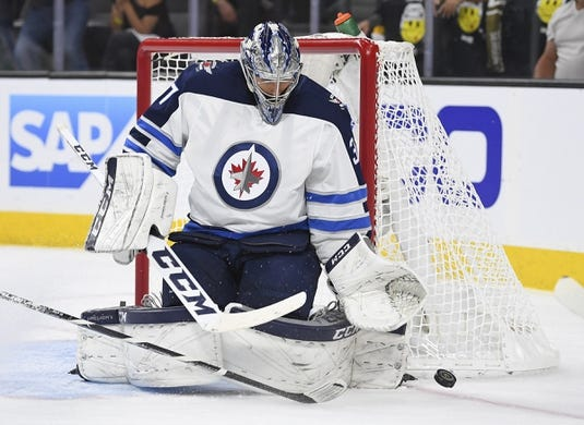 May 16, 2018; Las Vegas, NV, USA; Winnipeg Jets goalie Connor Hellebuyck (37) makes a save in game three of the Western Conference Final of the 2018 Stanley Cup Playoffs against the Vegas Golden Knights at T-Mobile Arena. Mandatory Credit: Stephen R. Sylvanie-USA TODAY Sports