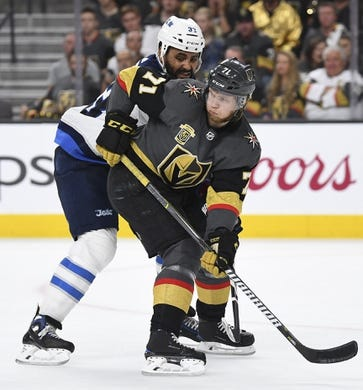 May 16, 2018; Las Vegas, NV, USA; Vegas Golden Knights center William Karlsson (71) skates defended by Winnipeg Jets defenseman Dustin Byfuglien (33) in game three of the Western Conference Final of the 2018 Stanley Cup Playoffs at T-Mobile Arena. Mandatory Credit: Stephen R. Sylvanie-USA TODAY Sports