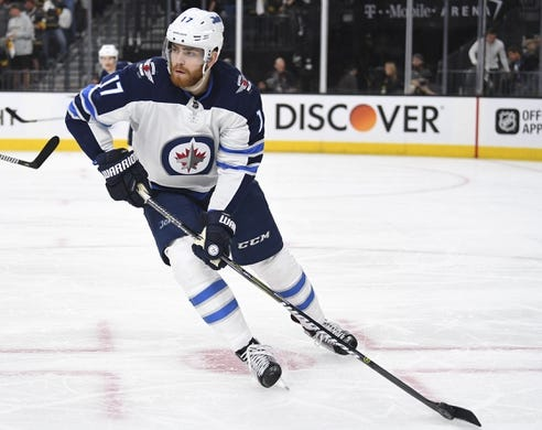 May 16, 2018; Las Vegas, NV, USA; Winnipeg Jets center Adam Lowry (17)in game three of the Western Conference Final of the 2018 Stanley Cup Playoffs at T-Mobile Arena. Mandatory Credit: Stephen R. Sylvanie-USA TODAY Sports