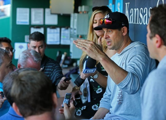 May 18, 2018; Kansas City, MO, USA; New York Yankees manager Aaron Boone (17) talks with reporters before the game against the Kansas City Royals at Kauffman Stadium. Mandatory Credit: Jay Biggerstaff-USA TODAY Sports