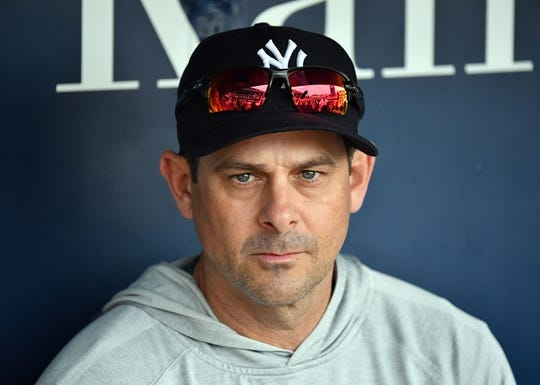 May 19, 2018; Kansas City, MO, USA; New York Yankees manager Aaron Boone (17) addresses the media during pre-game activities prior to a game against the Kansas City Royals at Kauffman Stadium. Mandatory Credit: Peter G. Aiken/USA TODAY Sports