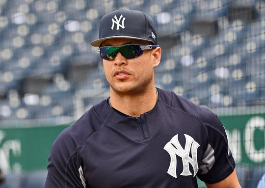 May 19, 2018; Kansas City, MO, USA; New York Yankees left fielder Giancarlo Stanton (27) looks on during pre-game activities prior to a game against the Kansas City Royals at Kauffman Stadium. Mandatory Credit: Peter G. Aiken/USA TODAY Sports