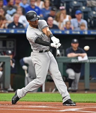 May 19, 2018; Kansas City, MO, USA; New York Yankees center fielder Aaron Hicks (31) singles during the first inning against the Kansas City Royals at Kauffman Stadium. Mandatory Credit: Peter G. Aiken/USA TODAY Sports
