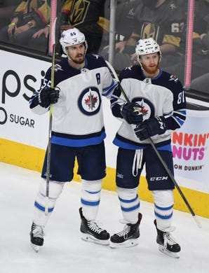 May 16, 2018; Las Vegas, NV, USA; Winnipeg Jets center Mark Scheifele (55) and left wing Kyle Connor (81) celebrate after a goal against the Vegas Golden Knights  in the second period of game three of the Western Conference Final of the 2018 Stanley Cup Playoffs at T-Mobile Arena. Mandatory Credit: Kirby Lee-USA TODAY Sports