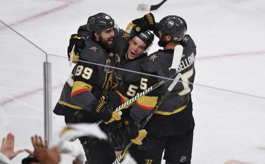 May 16, 2018; Las Vegas, NV, USA; Vegas Golden Knights left wing Erik Haula (56) celebrates with right wing Alex Tuch (89) and defenseman Deryk Engelland (5) after a goal in the second period against the Winnipeg Jets of game three of the Western Conference Final of the 2018 Stanley Cup Playoffs at T-Mobile Arena. Mandatory Credit: Kirby Lee-USA TODAY Sports