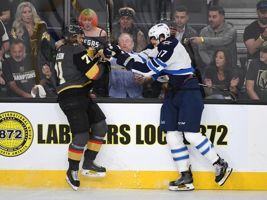 May 16, 2018; Las Vegas, NV, USA; Winnipeg Jets center Adam Lowry (17) checks Vegas Golden Knights center William Karlsson (71) during the first period of game three of the Western Conference Final of the 2018 Stanley Cup Playoffs at T-Mobile Arena. Mandatory Credit: Stephen R. Sylvanie-USA TODAY Sports